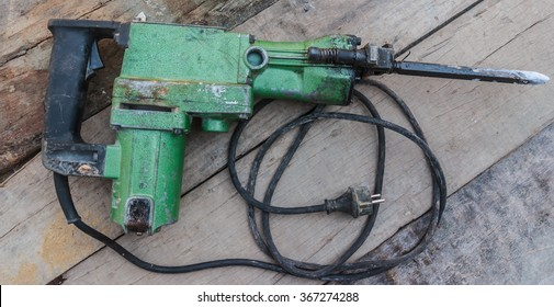Electric hammer Plugger on old wood
