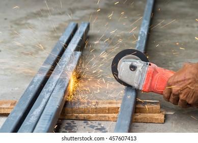 Electric hand wheel grinding on steel ,Grinder in hand