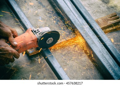 Electric hand wheel grinding on steel ,Grinder in hand with Vignette filter