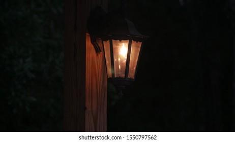 Electric hanging lamp lit at dusk
