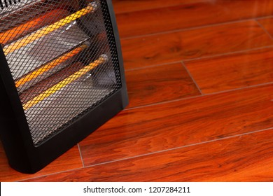 electric heater working in a room with copy space