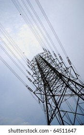 Electric high voltage post with sky background