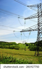 Electric high voltage power lines in the landscape