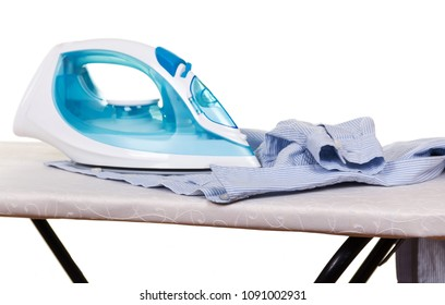 Electric iron and clean linen on Ironing Board isolated on white