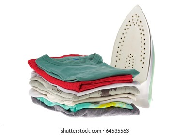 Electric iron and clothes after ironing isolated on white background.