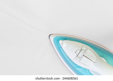 Electric iron on white fabric (with clipping path)