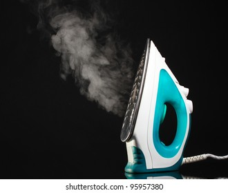 Electric iron with steam on black