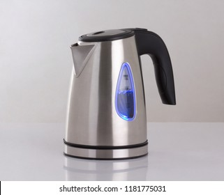 Electric kettle with blue lighting isolated on white background