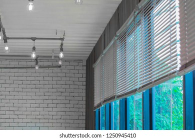 electric lamp lighting and vintage style , interior ceiling hanging light bulb and louvers, shutters, blind, roller, curtain, roll, shades decorate at room.