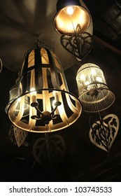 Electric lamps are in a dark cafe