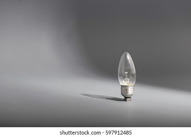 Electric light bulb on a gray background.