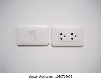 Electric light switch and plug on the empty wall