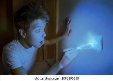Electric lightning bolt strikes a boy, who is touching wall plug. Be careful and cautious, electricity is dangerous. Voltage and Current concept