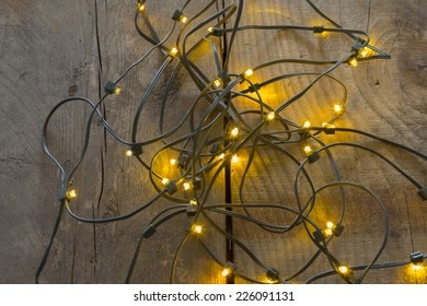 Electric lights need to be unraveled before decorating the christmas tree