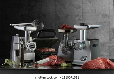 Electric meat grinders and electric grill ready for meat