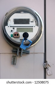 Electric meter on outside wall of house