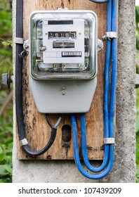 Electric meter on the power pole in countryside of Thailand