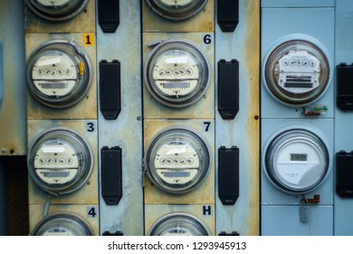 Electric meters measuring usage outside apartment building
