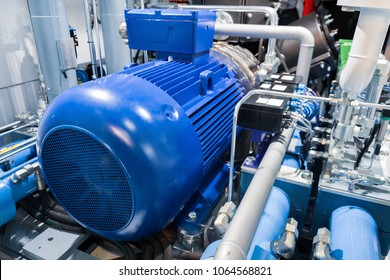 Electric motor of a powerful industrial gas compressor. Abstract industrial background.