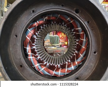 Electric motor stator with winding coil , view of inside of electric induction motor under repairing.