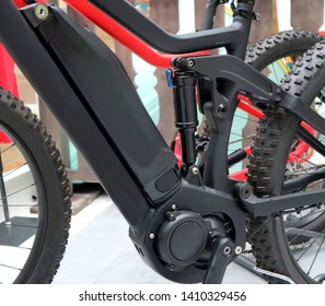 Electric mountain bike or e bicycle. Details of  motor, battery and suspension shock absorber.