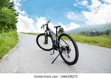 Electric Mountain Bike On Road In Austrian Mountains