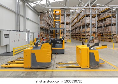 Electric Pallet Trucks and Forklift in Distribution Warehouse