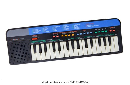 Electric piano keyboard for small kids isolated on the white background. With clipping path. Children plastic toy in the shape of musical instrument with colourful buttons. With vector path.