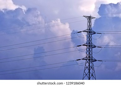 Electric pillar, high voltage line against  sky clouds.