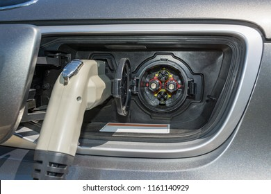 Electric plug connected to a vehicle for battery energy fulfil from charging station