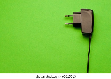 Electric plug isolated on the green background