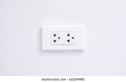 electric plugs on white wall