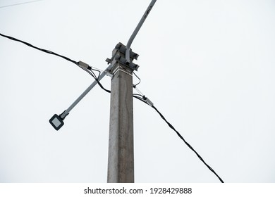 An electric pole against a clear gray sky.