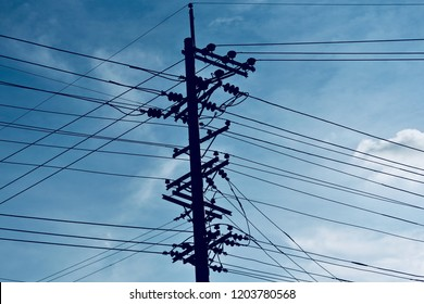 An electric pole with black cables isolated unique photo
