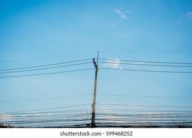 Electric pole, blue sky