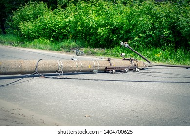 Electric pole. Broken broken wood power line post with electrical components on the ground after accident.