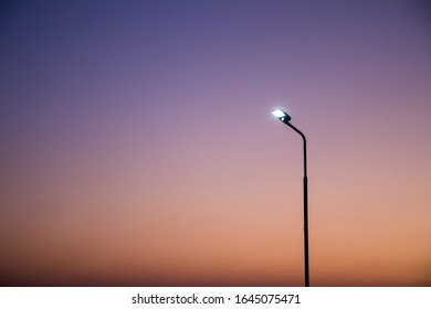 Electric pole with colorful sky on evening.