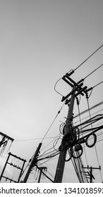 Electric pole and complex wire in black and white shot.