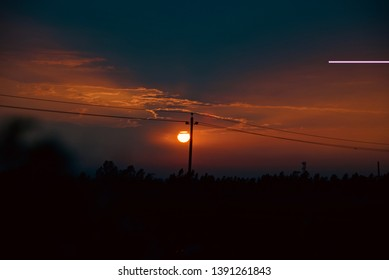 An electric pole with dark evening sky background photo