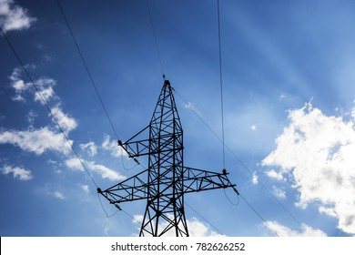 Electric pole high voltage isolated on cloudy blue sky