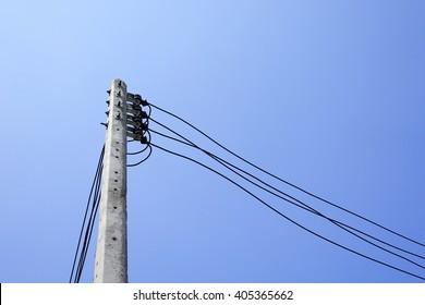 Electric pole with electric line on sky background:select focus with shallow depth of field.
