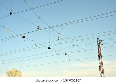 An electric pole made of metal on a railway to transmit power to trains.