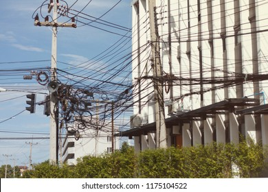 Electric pole with messy wire that look dangerous located in Nakhon Ratchasima, Thailand, 2018.