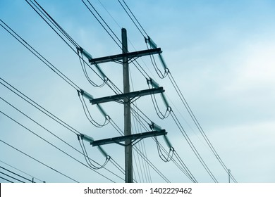 Electric pole for power height volt cable under blue sky in Thailand.