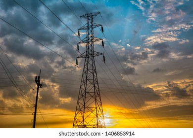Electric pole and sunset wit blue sky