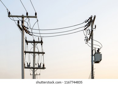 The electric pole and electric transformer with clear sky in sunset time.