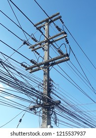 Electric pole with wires and blue sky.