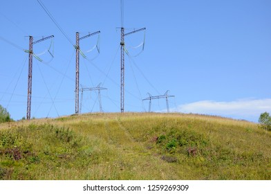 Electric poles among nature.