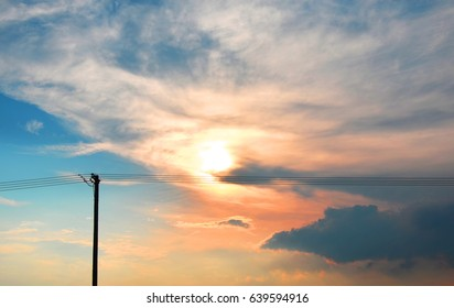 Electric poles on sky background