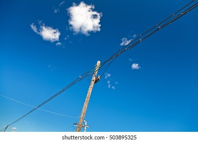 electric post against blue sky